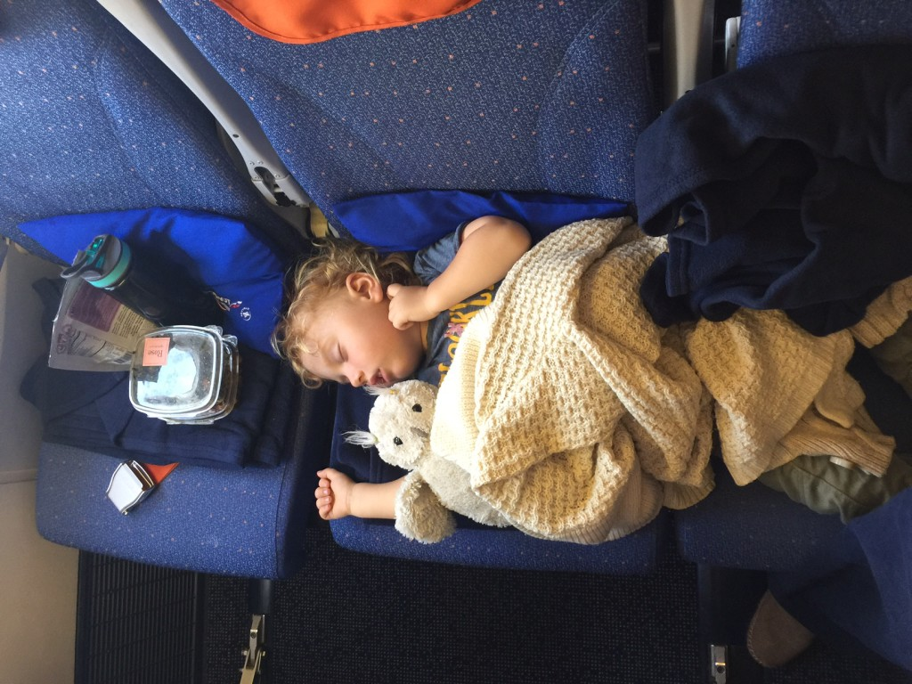 toddler traveling on airplane