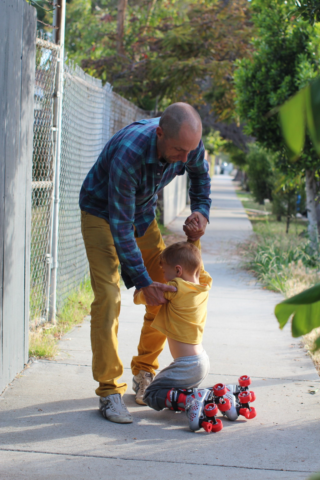father and son roller skate